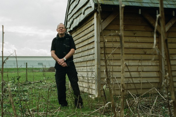 "<p>Bruce Podmore at ""the bat cave"", a building designed to help the local bat population reproduce, a requirement for Windles present location. </p>"